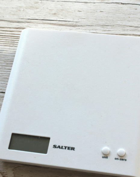 Weigh ingredients on a digital scale for gluten-free baking